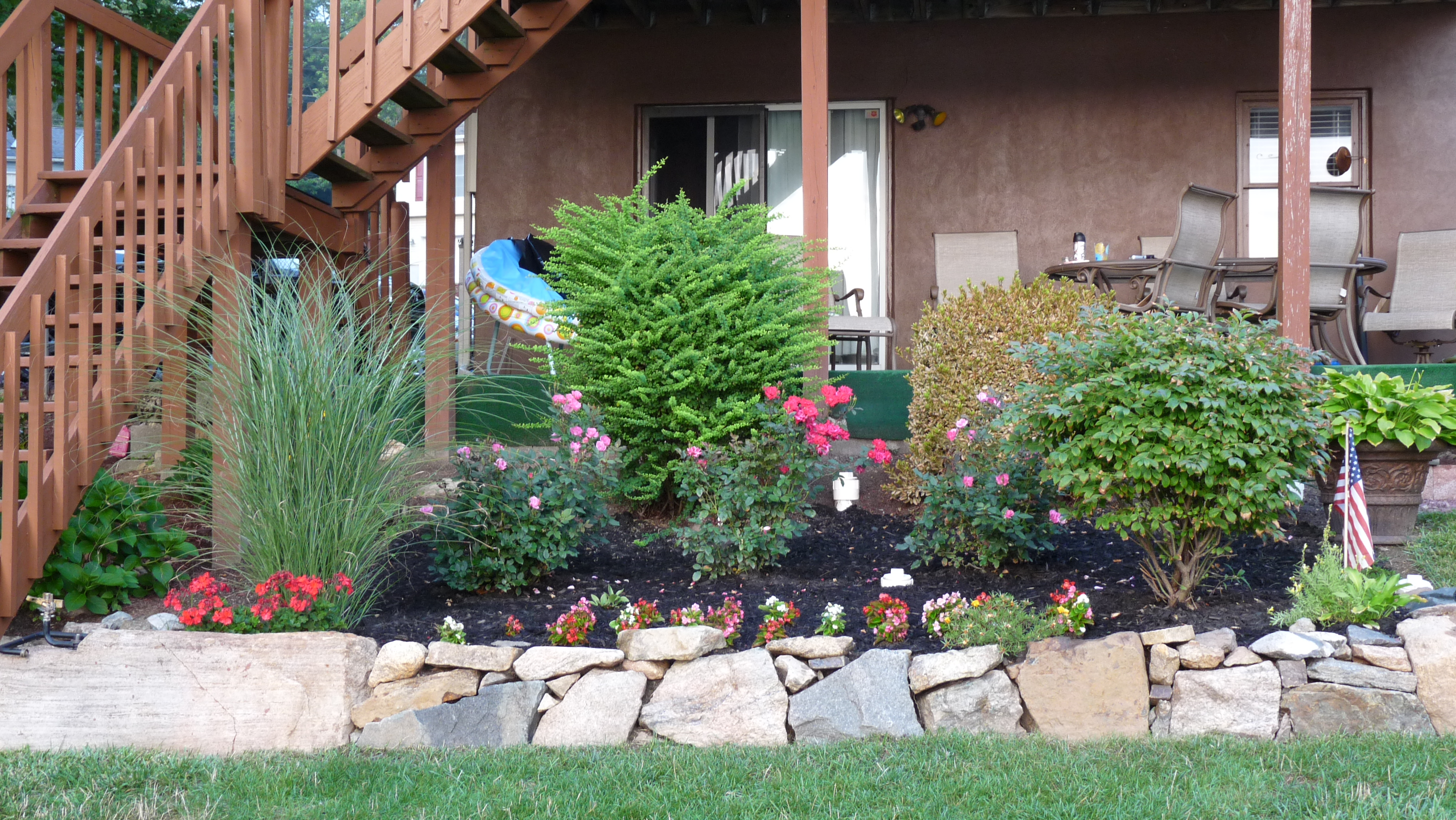 Our lake life how does your garden grow our lake life for How to plant bushes in front of house